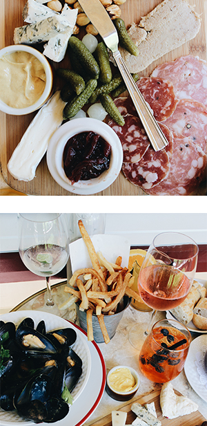 Charcuterie plate, bowl of mussels, french fries, and a cocktail from Bistro Maison