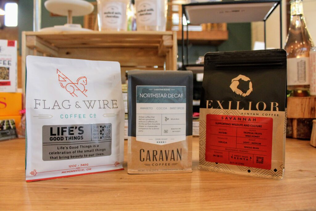 Bags of Flag & Wire Coffee, Caravan Coffee, and Exilior Coffee